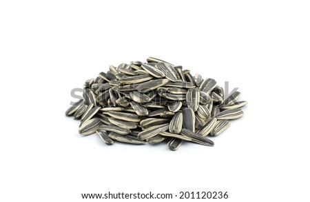 sunflower seeds on white background - stock photo