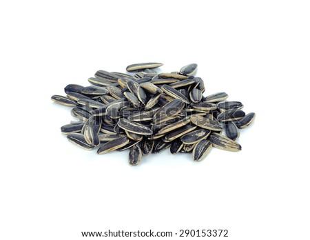 Sunflower seeds on white background. - stock photo