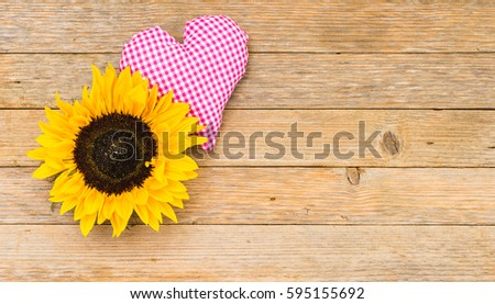 Sunflower With Pink Heart On Rustic Wood Background Copy Space