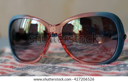 sunglasses and american flag - stock photo