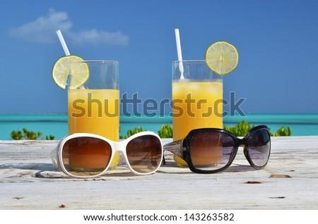Sunglasses and orange juice - stock photo