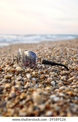 Sunglasses at beach sand - stock photo