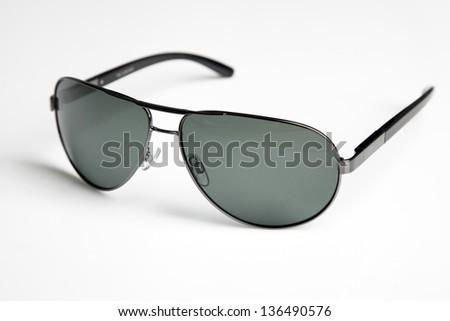 Sunglasses close-up studio photo - stock photo