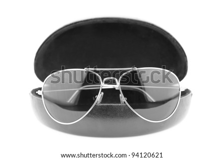 Sunglasses in case isolated on white