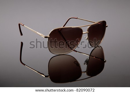 sunglasses on a grey background - stock photo