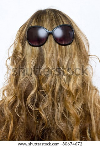 sunglasses on his head a beautiful girl - stock photo