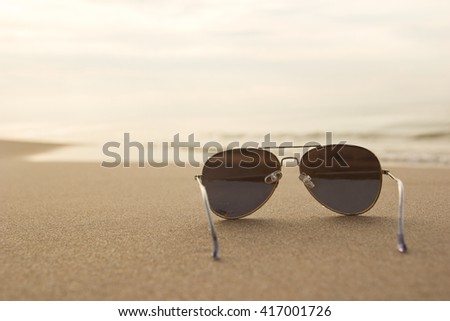 sunglasses on the beach - stock photo