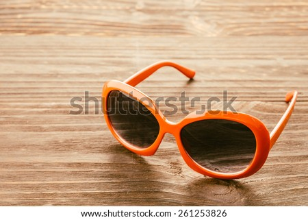 Sunglasses on wooden background - vintage effect - stock photo