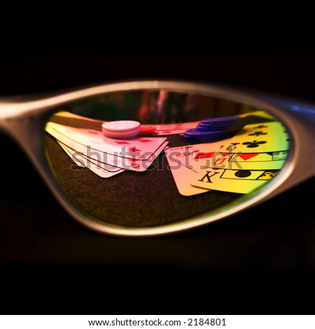 Sunglasses reflecting a poker game