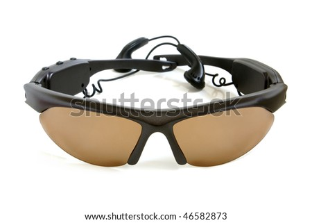 Sunglasses whis earphones on the white background - stock photo