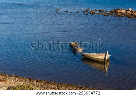 Sunken fishing boat wreck below water, abandoned in the small port of Lavrio in Greece - stock photo