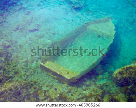 sunken wreck of a boat in the sea - stock photo