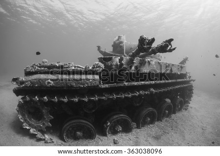 Sunken wreck of a tank in the Red Sea, Aqaba in Jordan. Black and white photo.