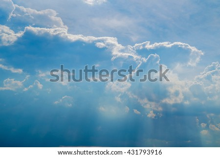 Sunlight and cloud on blue sky background. - stock photo