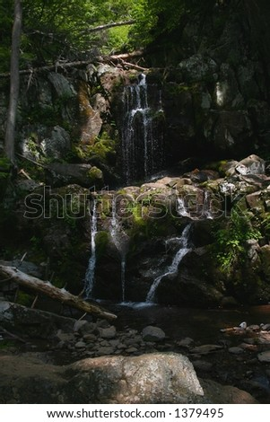 Sunlight Barely Shinning on Doyles River Waterfall - Shenandoah National Park in Virginia - stock photo