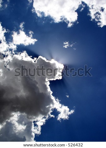 Sunlight glancing rays from behind clouds