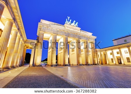 Sunlight illuminating Brandenburg Gate (1788) inspired by Greek architecture, built as a symbol of peace and nationalism, now an emblem of reunification. - stock photo