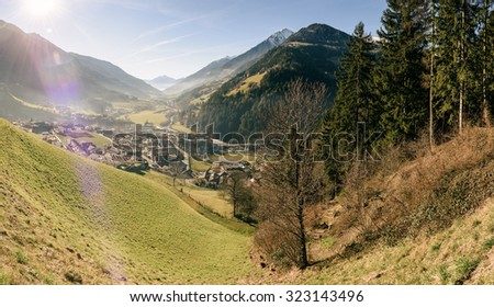 Sunlight in the Alpine valley in vintage style. South Tyrol. Italy - stock photo