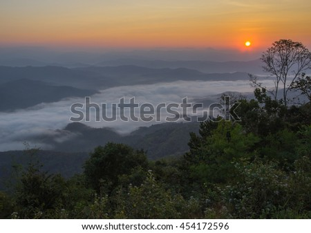 sunlight in the morning and many fog in valley at northern Thailand