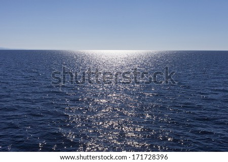 Sunlight on blue sea surface.
