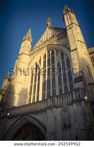 Sunlight on Winchester cathedral - stock photo