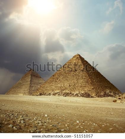 Sunlight over Giza pyramids. Egypt - stock photo