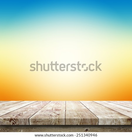 Sunlight over wood table. Beauty natural background - stock photo
