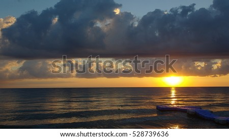 Sunlight reflected in the water at sunrise