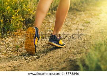 sunlight sports shoes feet men runners female large legs running, exercising and walking, fitness - stock photo