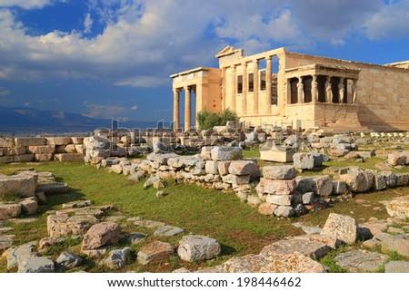Sunlit facade of the Erechtheion temple on the Athens Acropolis, Greece - stock photo