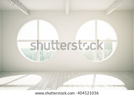 Sunlit interior design with wooden floor and round windows revealing city view. 3D Rendering - stock photo