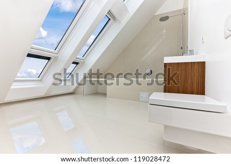 Sunlit modern bathroom of Contemporary apartment - stock photo