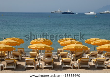 Sunlounger on the beach in Cannes, southern France - stock photo