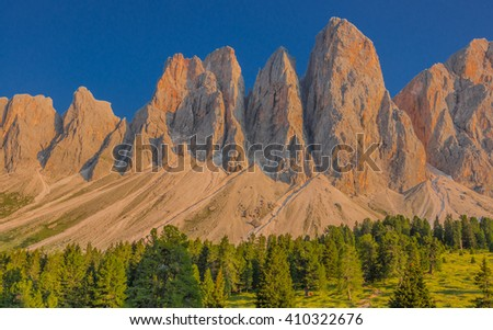 Sunny afternoon view of Odle mountain group knife-edge peaks as taken from Malga Glatsch refuge in Puez-Odle Nature park, Funes valley, Dolomites, Trentino Alto Adige, Bolzano, South Tyrol, Italy