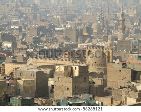sunny and misty aerial view of Cairo including the Mosque of Ibn Tulun (Egypt) - stock photo