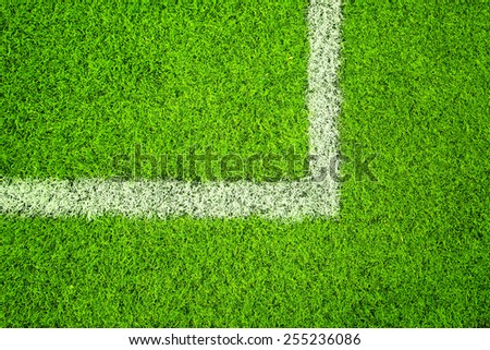 Sunny artificial green grass with white line corner background.  - stock photo