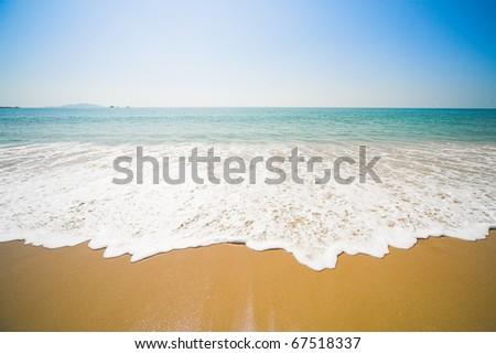 sunny beach, blue ocean and clean sky - stock photo