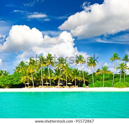 sunny beach landscape with beautiful cloudy blue sky - stock photo