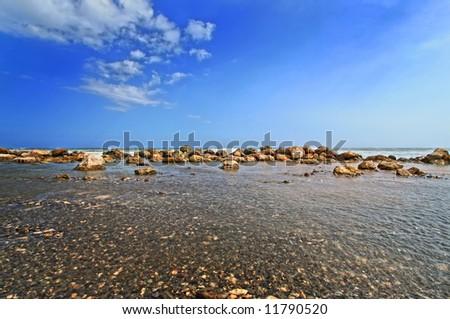sunny beach scene shoreline - stock photo