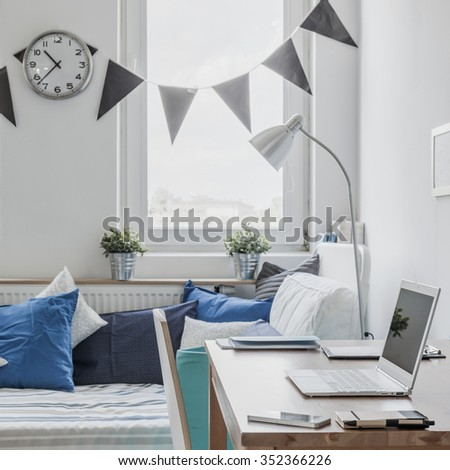 Sunny bedroom for boy in the house - stock photo