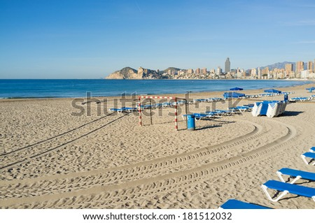 Sunny Benidorm beach with deckchairs ready for holidaymakers - stock photo