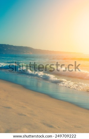 Sunny bright colorful day and wavy ocean, vibrant colors - stock photo