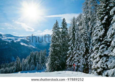 Sunny day at Val Di Fassa ski resort in Italy - stock photo