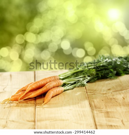 sunny day in garden fresh carrots and wooden board place
