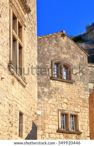 Sunny facades of historical buildings in Les Baux de Provence, Provence, France - stock photo