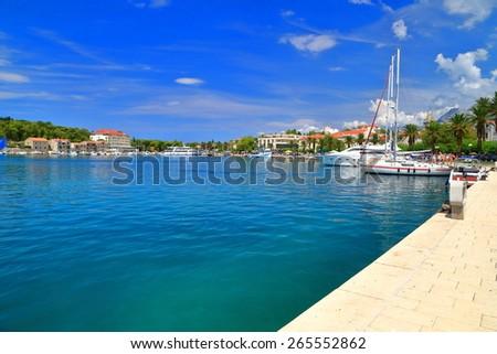 Sunny harbor with sail boats on the Adriatic sea, Makarska, Croatia - stock photo