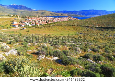 Sunny hills of Greece and distant village on the Ioanian sea shore, Greece - stock photo