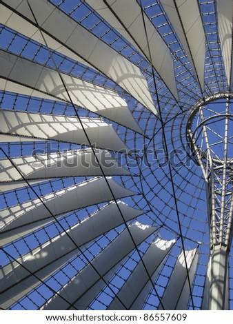 sunny illuminated roof detail of the Sony Center in Berlin (Germany) - stock photo