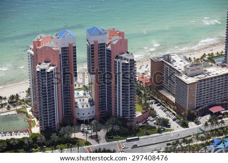 SUNNY ISLES BEACH - JULY 10: Aerial photo of the Ocean Two Condominiums which is a residential highrise located on Collins avenue built in 2003 located on Collins Avenue July 10, 2015 in Sunny Isles. - stock photo