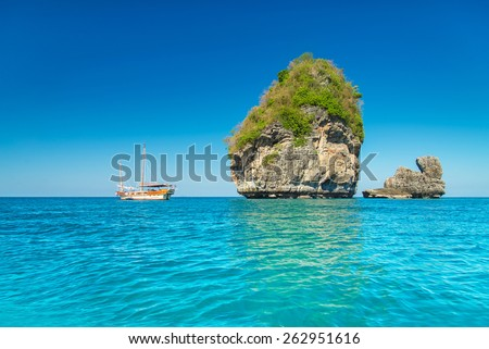 Sunny Nui Bay Beach with yacht, Camel rock view, Thailand, Ko Phi Phi Don, Krabi province, Andaman sea - stock photo